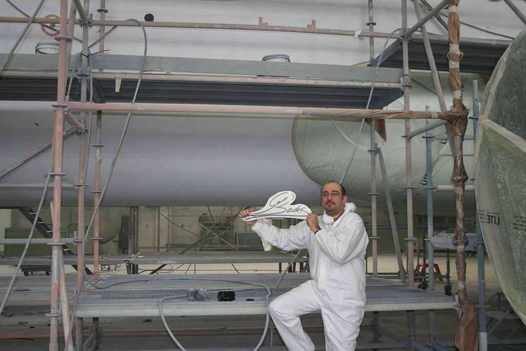 Bader showing his signature before spraying it on the A320 in Norwich, UK in 2009