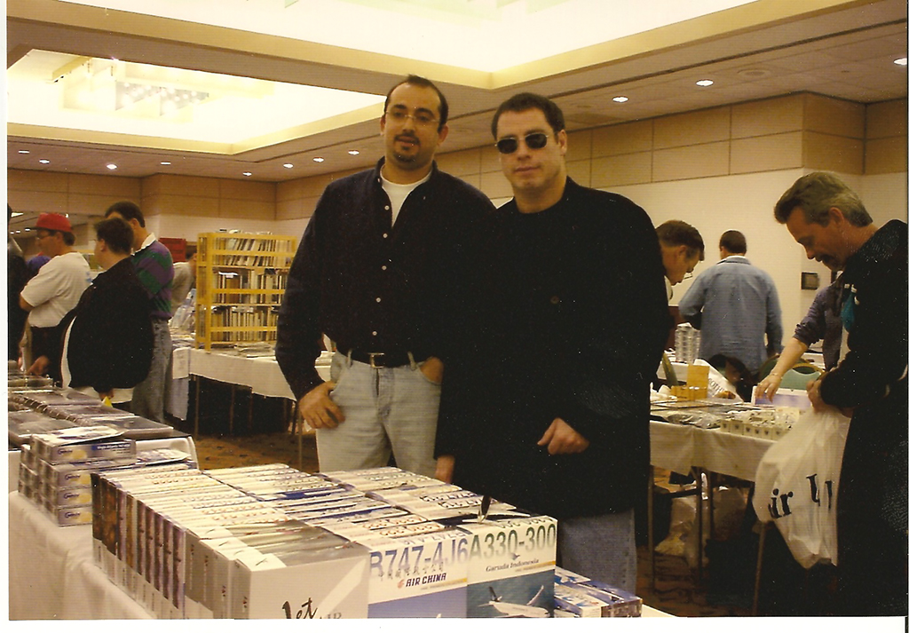 Bader meeting John Travolta in California during the Aircraft Models Trade Show in 2002